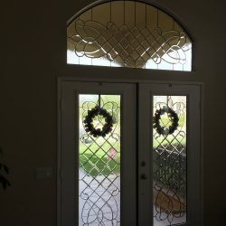 Two decorative glass doors with wrought iron and swirl glass - Your Door Our Glass