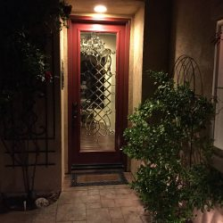 An entry door with clear decorative glass design - Your Door Our Glass
