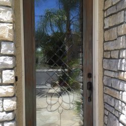 Beautiful decorative glass door with reflection from outside - Your Door Our Glass