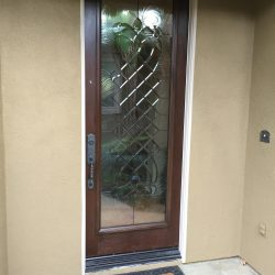 Entry door with swirl glass design and clear glass - Your Door Our Glass