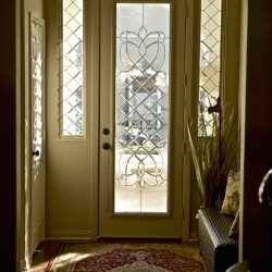 Tall white door with decorative glass design and half length transoms - Your Door Our Glass