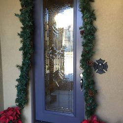 Decorations surrounding a Savoy glass door