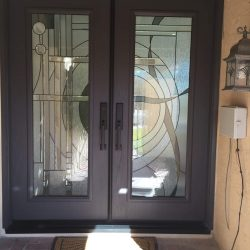 Two wooden doors with a decorate glass design - Your Door Our Glass