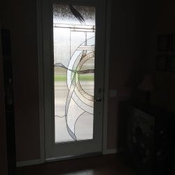 A front door using decorate glass to create a frosted effect - Your Door Our Glass