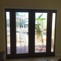 Two decorative glass doors using linear and curved lines - Your Door Our Glass