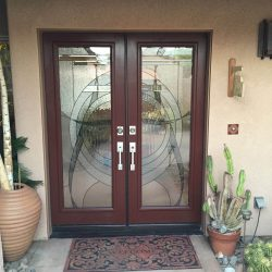 Two decorative glass doors with light from the outside - Your Door Our Glass