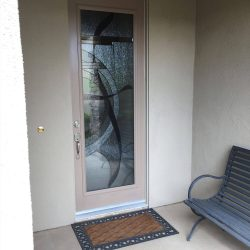 View from outside looking at a decorative glass door - Your Door Our Glass
