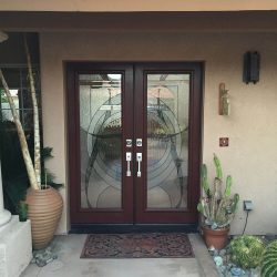 Two glass panels combined to create a unique design - Your Door Our Glass