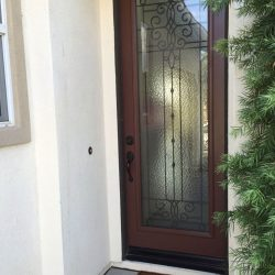 Veranda glass door entrance tucked into a sleek doorway