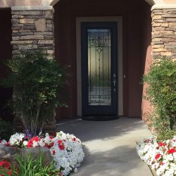 Image Of Custom Door Behind Shrubbery