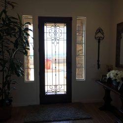 Plants surrounding Veranda glass door entrance