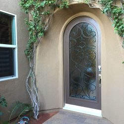 Elegant home exterior equipped with custom Vistain glass door