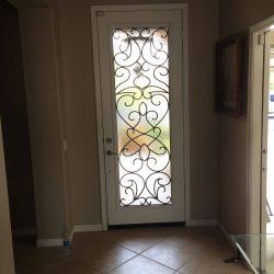 Vistain glass doorway with tile flooring