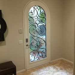 Custom arch shaped door with Vistain glass pattern