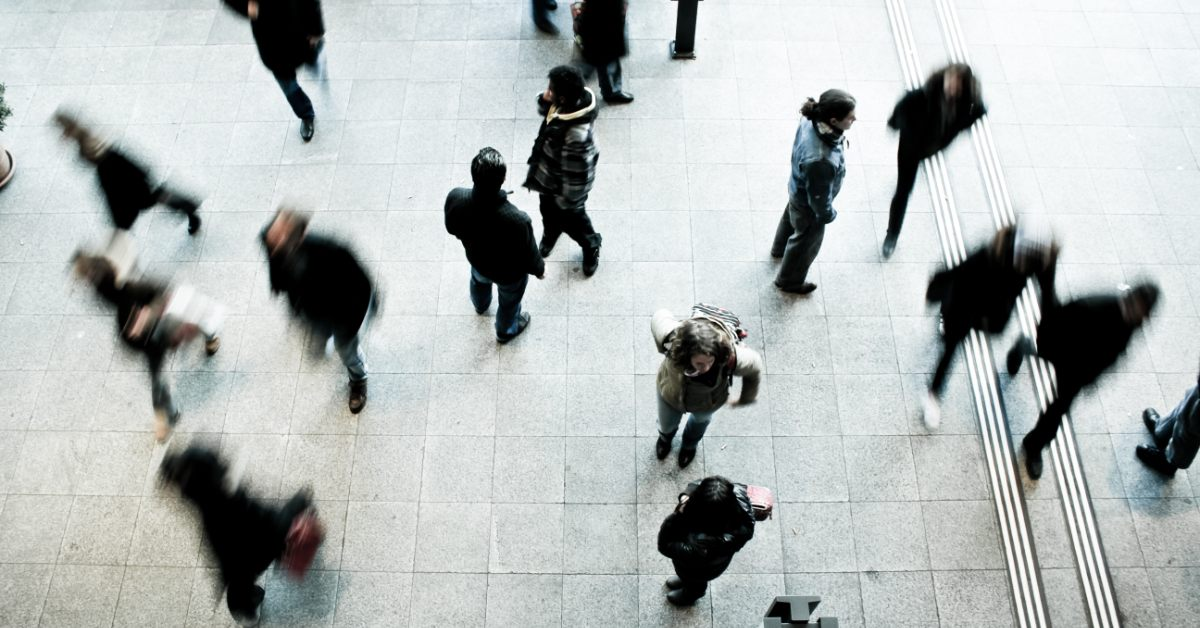 On overhead view of a group of people walking in a city.