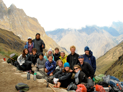 Group poses during a trek in the Andes