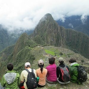 Group of students enjoy a view over Machu Picchu