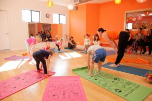 Kids practicing sun salutations at Zooga Yoga South Bay