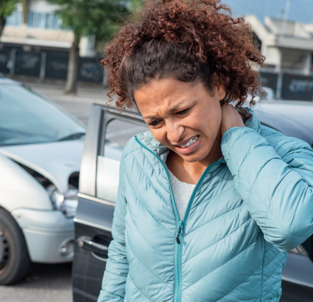 Woman in pain after an auto accident. Totally not her fault!